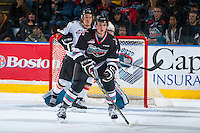 KELOWNA, CANADA - OCTOBER 24: Gordie Ballhorn #4 of Kelowna Rockets looks for the pass against the Calgary Hitmen on October 24, 2015 at Prospera Place in Kelowna, British Columbia, Canada.  (Photo by Marissa Baecker/Shoot the Breeze)  *** Local Caption *** Gordie Ballhorn;