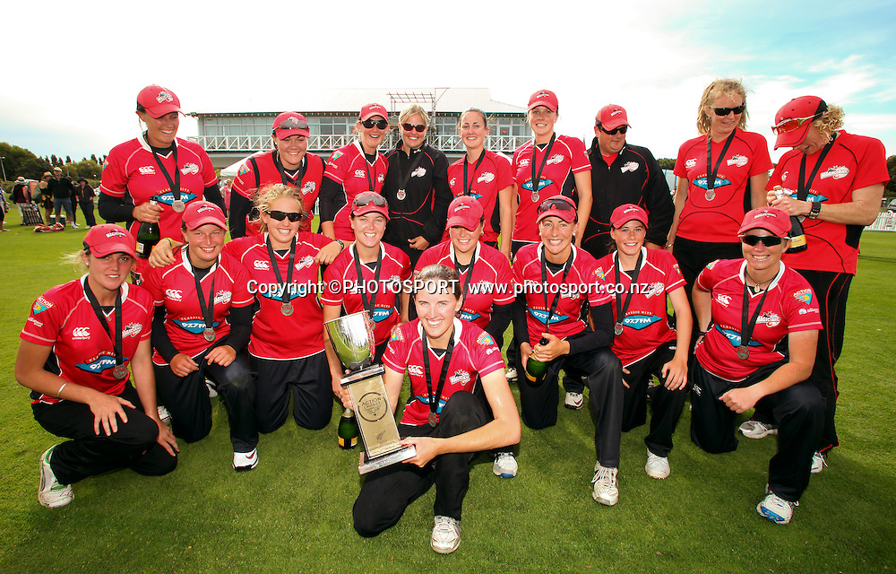 Canterbury captain Amy Satterthwaite with the Action one day trophy celebrate with the rest of the Canterbury team. Canterbury Magicians v Wellington Blaze in the Action Cricket Cup Final. Women's Cricket. QEII Park, Christchurch, New Zealand. Sunday, 30 January 2011. Joseph Johnson / PHOTOSPORT.