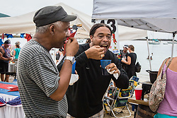 Leon Pickering, Sr. , left, and Marvin Bramble are delighted by the 3 beans Vegetarian Chili by Marriott Frenchman's Reef.  31st Annual Texas Society Chilli Cookoff Brewers Bay.  St. Thomas, USVI.  16 August 2015.  © Aisha-Zakiya Boyd