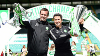 24/05/15 SCOTTISH PREMIERSHIP<br /> CELTIC v INVERNESS CT<br /> CELTIC PARK - GLASGOW<br /> Celtic manager Ronny Deila (left) and assistant John Collins celebrate with the Scottish League Cup and the Scottish Premiership trophy
