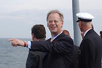 09 AUG 2001, BERLIN/GERMANY:<br /> Rudolf Scharping, SPD, Bundesverteidigungsminister, waehrend einem Besuch von Marineeinheiten im Seegebiet vor Rostock,  auf dem Tender DONAU<br /> IMAGE: 20010809-01-013<br /> KEYWORDS: Bundeswehr, Bundesmarine, Marine