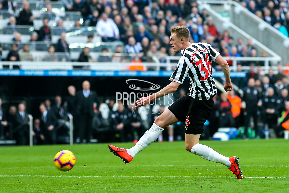 Sean Longstaff (#36) of Newcastle United shoots from just inside the penalty box during the Premier League match between Newcastle United and Huddersfield Town at St. James's Park, Newcastle, England on 23 February 2019.