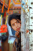 Afghan refugee girl waiting at a United Nations High Commission for Refugees (UNHCR) screening center in Peshawar, Pakistan. 2002.