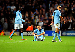 Manchester City's Aleksandar Kolarov, Manchester City's Jack Rodwell and Manchester City's Yaya Toure are all disappointed at only getting a point from the game - Photo mandatory by-line: Joe Meredith/JMP  - Tel: Mobile:07966 386802 03/10/2012 - Manchester City v Borussia Dortmund - SPORT - FOOTBALL - Champions League -  Manchester   - Etihad Stadium -