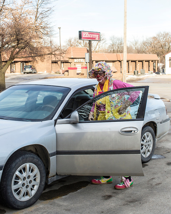 Kate Quimby, who performs as Tickle the Clown, puts her clowning equipment in her car on Sunday, January 19, 2014, in Webster City, IA.