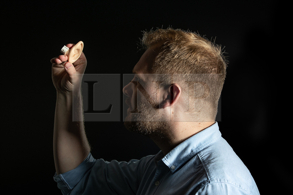 © Licensed to London News Pictures. 10/07/2019. Manchester, UK. A model of a human ear, used to test doctors in the examination and diagnosis of ear conditions, is checked by the GMC's Paul Boden, ahead of the move. General Medical Council (GMC) staff prepare for the opening of the regulator's new test facility in central Manchester. The £2.5m clinical assessment centre in the city's Spinningfields district will assess the skills of overseas-trained doctors who want to work in the UK. Once it opens in early August, more than 1,000 doctors per month will undergo a series of practical tests to show they have the skills required for a licence to practise medicine in the UK. It will replace the GMC's existing test centre, which has a more limited capacity. Photo credit: Joel Goodman/LNP