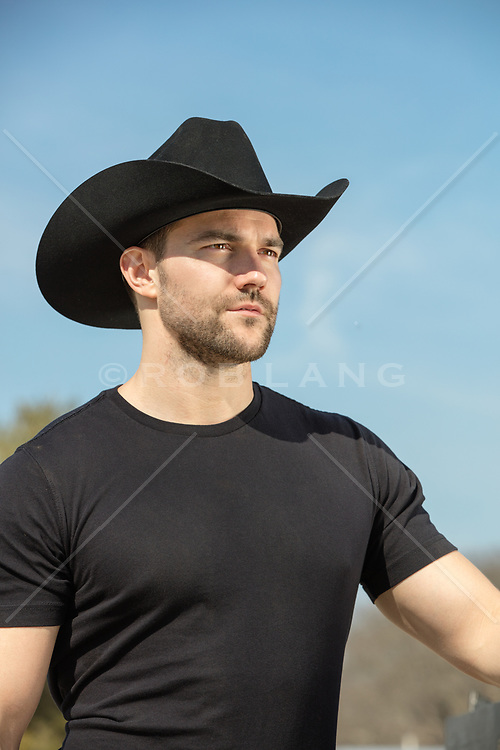 sexy cowboy looking off