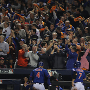 New York Mets fans celebrate three runs scoring on a Curtis Granderson double during the New York Mets Vs Los Angeles Dodgers, game three of the NL Division Series at Citi Field, Queens, New York. USA. 12th October 2015. Photo Tim Clayton for The Players Tribune