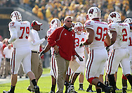 18 OCTOBER 2008: Wisconsin head coach Bret Bielema talks to his defense as the run off the field in the first half of an NCAA college football game against Wisconsin, at Kinnick Stadium in Iowa City, Iowa on Saturday Oct. 18, 2008. Iowa won 38-16.
