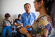 "31 MARCH 2013 - BANGKOK, THAILAND:     Sanyasin (Neung) Charoensuksap talks ""Nim"" after Easter services at the Thai Peace Foundation office in the Bangkapi section of Bangkok.     PHOTO BY JACK KURTZ"