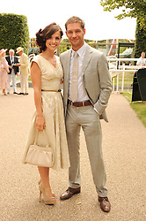TOM HARDY and CHARLOTTE RILEY at the third day of the 2010 Glorious Goodwood racing festival at Goodwood Racecourse, Chichester, West Sussex on 29th July 2010.