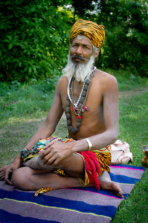 A Hindu holy man, known as a Sadhu, lives with nearly no posessions and survives on alms. Agra, India.