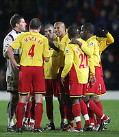 Photo: Marc Atkins.<br /> Watford v Blackburn Rovers. The Barclays Premiership. 23/01/2007. Waford players celebrate in a huddle at the end of the game after Jay Demerit scores the winning goal.