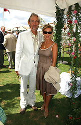 MIKE & ANGIE RUTHERFORD at the Cartier International polo at Guards Polo Club, Windsor Great Park, on 30th July 2006.<br />