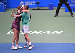 WUHAN, Sept. 28, 2018  Elise Mertens (L) of Belgium and Demi Schuurs of the Netherlands celebrate after winning the doubles semifinal match against Shuko Aoyama of Japan and Lidziya Marozava of Belarus at the 2018 WTA Wuhan Open tennis tournament in Wuhan, central China's Hubei Province, on Sept. 28, 2018. Elise Mertens and Demi Schuurs won 2-1. (Credit Image: © Xiao Yijiu/Xinhua via ZUMA Wire)