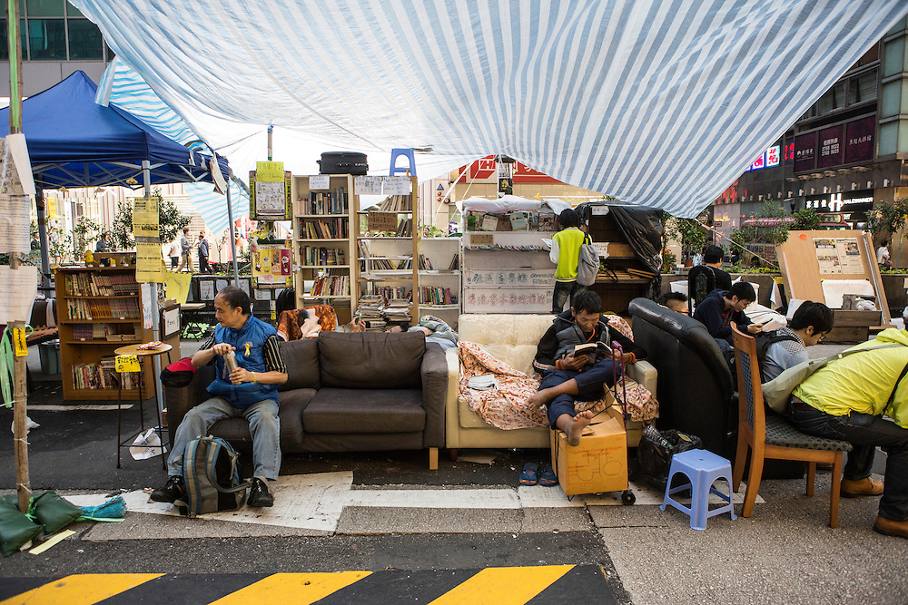 A space to relax in the middle of theprotest site that has been blockading Mong Kok since late September. Protesters known as the Umbrella Revolution or Occupy Mongkok, an extension of the larger Occupy Central movement, have taken over a number of blocks on the busy road and staged an ongoing demonstration calling for universal suffrage for Hong Kong.