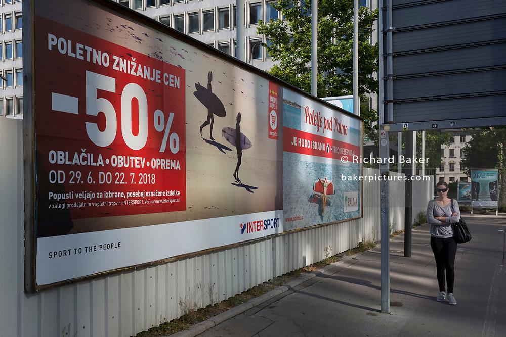 Billboard advertising selling summer sports goods reductions on Slovenska Cesta (street) in the Slovenian capital, Ljubljana on 27th June 2018, in Ljubljana, Slovenia.