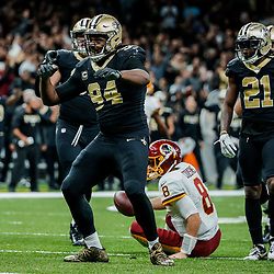 Nov 19, 2017; New Orleans, LA, USA; New Orleans Saints defensive end Cameron Jordan (94) celebrates after a sack against the Washington Redskins during overtime of a game at the Mercedes-Benz Superdome. The Saints defeated the Redskins 34-31 in overtime. Mandatory Credit: Derick E. Hingle-USA TODAY Sports