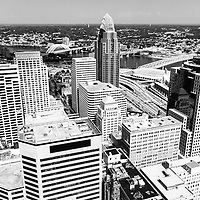 Cincinnati aerial skyline black and white picture of downtown city buildings, bridges, Ohio river, and sports stadiums including Great American Ballpark, Great American Insurance Group Tower, US Bank building, and Scripps Center building. Photo was taken in July 2012.
