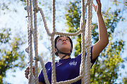 Helen Stec climbs up the ziplining tower at the Challenge Course at The Ridges. Photo by Hannah Ruhoff