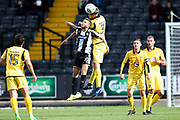 Notts County midfielder Jorge Grant (10), on loan from Nottingham Forest, is out jumped by Morecambe defender Patrick Brough (3)  during the EFL Sky Bet League 2 match between Notts County and Morecambe at Meadow Lane, Nottingham, England on 9 September 2017. Photo by Simon Davies.