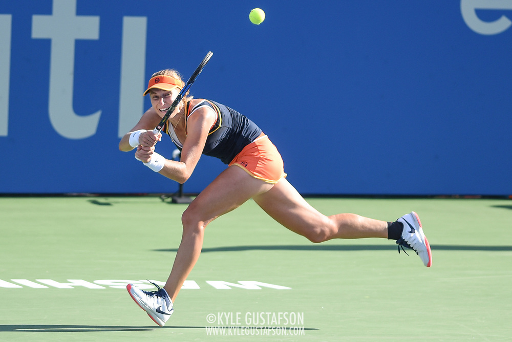 EKATERINA MAKAROVA hits a running backhand during her semifinal match at the Citi Open at the Rock Creek Park Tennis Center in Washington, D.C.