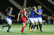 Lucy Whipp swamped by teammates inc Dani Young 17 and Millie Turner 21 during the Women's FA Cup fourth round match between Everton Ladies and Bristol Academy ladies at the Select Securities Stadium, Widnes, United Kingdom on 24 March 2015. Photo by Andrew Morfett.
