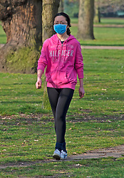 ©Licensed to London News Pictures 08/04/2020  <br /> Greenwich, UK. A walker wearing a face mask this morning. People get out of the house from Coronavirus lockdown to exercise and enjoy the sunny weather in Greenwich park,Greenwich, London. Photo credit:Grant Falvey/LNP