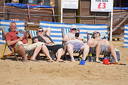 © Licensed to London News Pictures. 31/07/2020. Scarborough, UK. Members of the public enjoy the hottest day of the year on Scarborough beach this afternoon. Sun-seekers flock to the seafront in Scarborough as temperatures are expected to reach 30 degrees Celsius in England. Photo credit: Ioannis Alexopoulos/LNP
