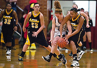 JEROME A. POLLOS/Press..North Idaho College's Marielle McKean gets tangled with Shauneice Samms, of College Southern Idaho, as they battle for a loose ball during the second half.