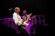 Francis Rossi and musician John (Rhino) Edwards of rock band Status Quo play guitar during gig on European tour in France..