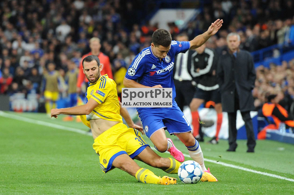 Chelseas Eden Hazard and Maccabi Tell-Avivs Yuval Shpungin in action during the Chelsea v Maccabi Tell-Aviv champions league match in the group stage.