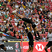 All Black Kurt Baker stretches to receive Fiji's opening kickat the Singapore 7's Day 2, Singapore National Stadium, Singapore, Singapore.  Fiji beat NZ 24-19.  Photo by Barry Markowitz, 4/29/18 , 2:30pm