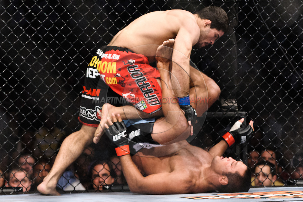 """ATLANTA, GEORGIA, SEPTEMBER 6, 2008: Rousimar Palhares (top) tries to work past the defences of Dan Henderson during """"UFC 88: Breakthrough"""" inside Philips Arena in Atlanta, Georgia on September 6, 2008"""