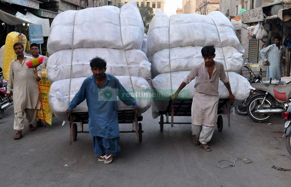 June 5, 2017 - Pakistan - HYDERABAD, PAKISTAN, JUNE 05: Laborer carrying load on handcart to earn his livelihood .for support of his family, in Hyderabad on Monday, June 05, 2017. (Credit Image: © PPI via ZUMA Wire)