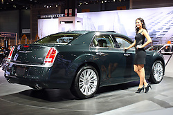08 February 2012:  2012 CHRYSLER 300: Freshened last year, the Chrysler 300 series continues its iconic rear-wheel-drive configuration, avant-garde exterior features, upgraded interiors and for 2012, the first eight-speed automatic transmission in a domestic luxury sedan. Initially, the ZF-licensed eight-speed gearbox with steering-wheel mounted paddle shifters will be mated exclusively to the 292 horsepower 3.6-liter Pentastar V6, including AWD models. The result is a boost in performance and fuel mileage. Trim levels are the base 300, Limited, 300C and performance-tuned SRT8, plus two new models - the 300S and 300C Luxury. Stock power on the 300C is the 363 hp 5.7L V8. A 6.4-liter Hemi V8 that pumps out 470 hp and 470 ft. lbs. of torque is standard on the STR8. Both V8s come with five-speed automatic transmissions. The five-passenger interior of the 300 exudes luxury and the trunk handles 16.3 cubic feet of luggage. Available on some series is the Uconnect Touch 8.4 with an 8.4-inch touchscreen display and next-generation mobile infotainment, connectivity and multimedia features. Beats by Dr. Dre audio technology that includes a 522-watt 12-channel amplifier is standard on 2012 Chrysler 300S and available on other 300 models. Chicago Auto Show, Chicago Automobile Trade Association (CATA), McCormick Place, Chicago Illinois