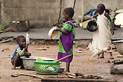 Children clean dishes in the village of Lalo, Benin on Tuesday September 18, 2007.