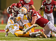 Nov 12, 2011; Fayetteville, AR, USA;  Arkansas Razorbacks running back Dennis Johnson (33) is brought down by defensive back Brian Randolph (37) and linebacker A.J. Johnson (45) during a game at Donald W. Reynolds Razorback Stadium. Arkansas defeated Tennessee 49-7. Mandatory Credit: Beth Hall-US PRESSWIRE