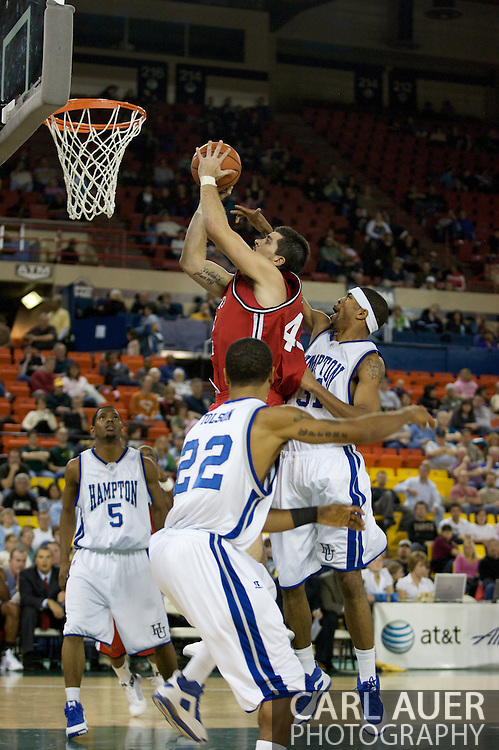 November 29, 2008: San Diego State's Ryan Amoroso (43) slips through the Hampton defense in the championship game of the 2008 Great Alaska Shootout at the Sullivan Arena.  San Diego State would keep Hampton scoreless for most of the first 7 minutes of the game and never look back on the Aztec's run to the win Saturday night.