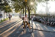 Een vrouw fietst met een OV-fiets door Utrecht.<br /> <br /> A woman is cycling on a rental bike near the station of Utrecht