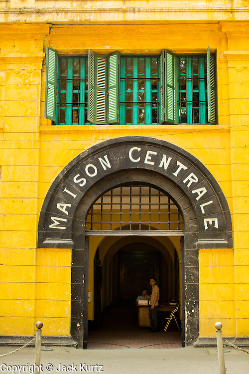 """01 APRIL 2012 - HANOI, VIETNAM: The main entrance to Hoa Lo Prison, also known infamously as the Hanoi Hilton, in Hanoi, the capital of Vietnam. In colonial times, the French used Hoa Lo to house and torture political prisoners and common criminals. During the """"American War"""" (what the Vietnamese call the war with the US), the prison was used to house American flyers shot down over the north. Most of the prison has been torn down and the grounds turned into an expensive international hotel.          PHOTO BY JACK KURTZ"""