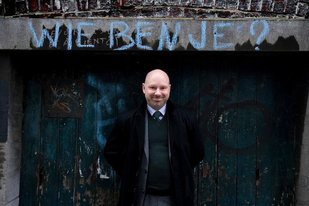 BRUSSELS - BELGIUM - 17 NOVEMBER 2008 -- Søren (Soeren, Soren) Hyldstrup LARSEN, Director EU Affairs at Danish Transport and Logistics Association (DTL).  Her standing under the dutch graffiti text, Wie ben je?, which means: Who are you?  Photo: Erik Luntang