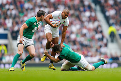 England Outside Centre Jonathan Joseph is tackled by Ireland Fly-Half Johnny Sexton and Flanker Peter O'Mahony - Mandatory byline: Rogan Thomson/JMP - 07966 386802 - 05/09/2015 - RUGBY UNION - Twickenham Stadium - London, England - England v Ireland - QBE Internationals 2015.