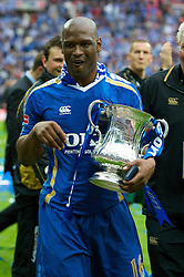 LONDON, ENGLAND - Saturday, May 17, 2008: Portsmouth's Noe Pamarot celebrates with the trophy after their side beat Cardiff City 1-0 during the FA Cup Final at Wembley Stadium. (Photo by David Rawcliffe/Propaganda)