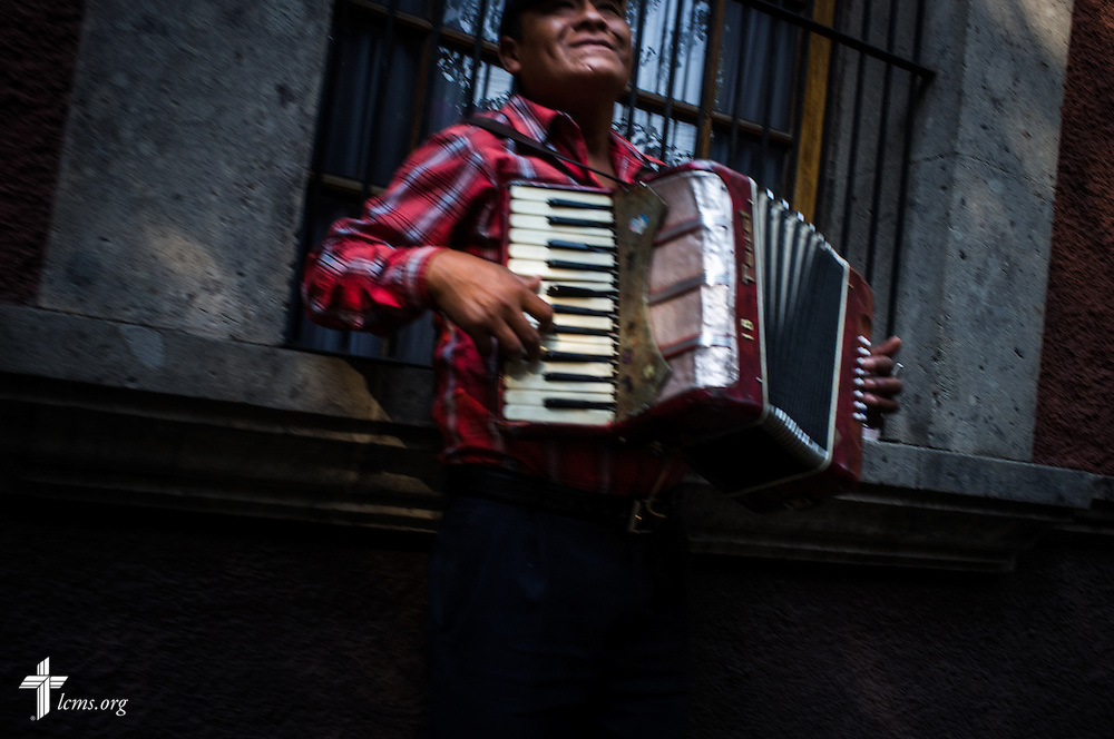 A man plays the accordion for passerby in Mexico City on Sunday, Jan. 15, 2017. Erik M. Lunsford