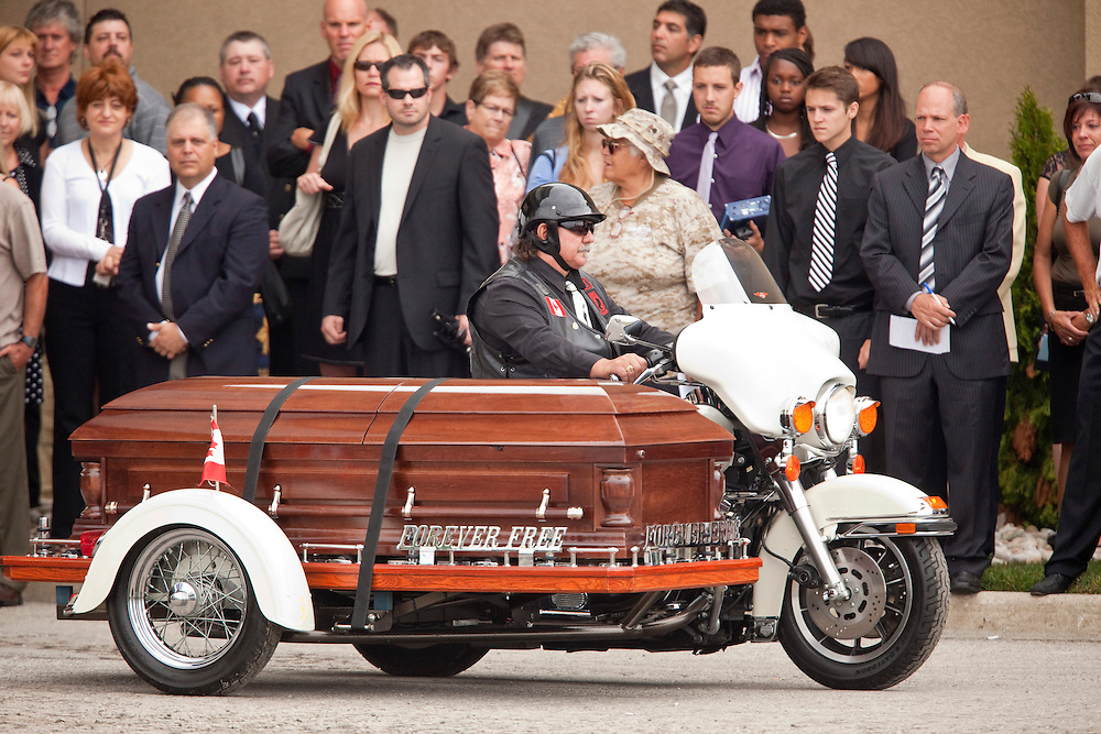 Mourners pay their respects as Bob Probert's casket leaves Windsor Christian Fellowship church in Windsor, Ontario July 9, 2010 following the Detroit Red Wings enforcer's sudden death earlier this week at the age of 45.<br /> The Canadian Press/GEOFF ROBINS