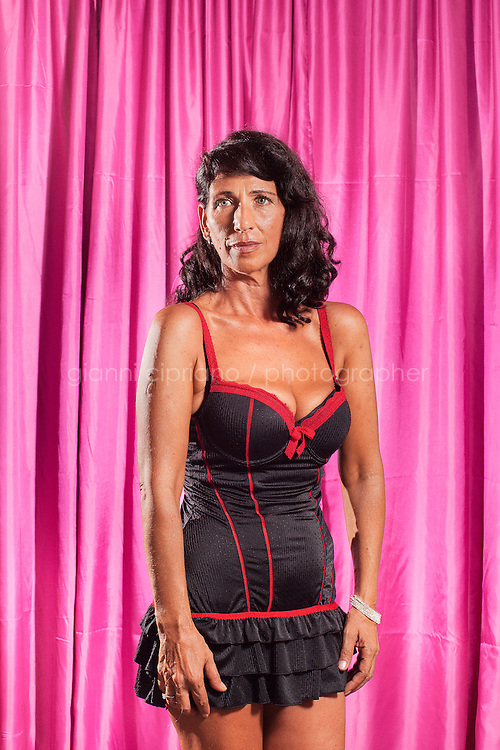 RICCIONE, ITALY - 24 AUGUST, 2011: Franca, 53, participates at Miss Chirurgia Estetica (Miss Plastic Surgery), a plastic surgery beauty pageant at the Beach Cafe in Riccione, Italy.