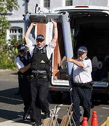 © Licensed to London News Pictures. 26/08/2019. London, UK. Police erect a metal detector at day two of the Notting Hill carnival. The two day event is the second largest street festival in the world after the Rio Carnival in Brazil, attracting over 1 million people to the streets of West London. Photo credit: Ben Cawthra/LNP