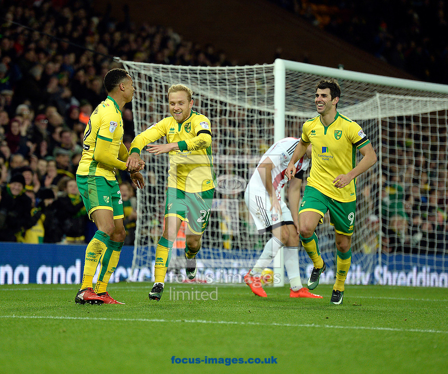 Alex Pritchard of Norwich City celebrates with Jacob Murphy and Nelson Oliveira, scoring the fifth goal against Brentford during the Sky Bet Championship match at Carrow Road, Norwich<br /> Picture by Matthew Usher/Focus Images Ltd +44 7902 242054<br /> 03/12/2016