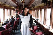 Maria Morris serves refreshments in the parlor car of the historic Cumbres & Toltec scenic train.